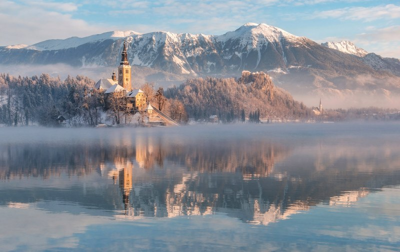 Lake Bled with the church and the castle on a calm winter mornin